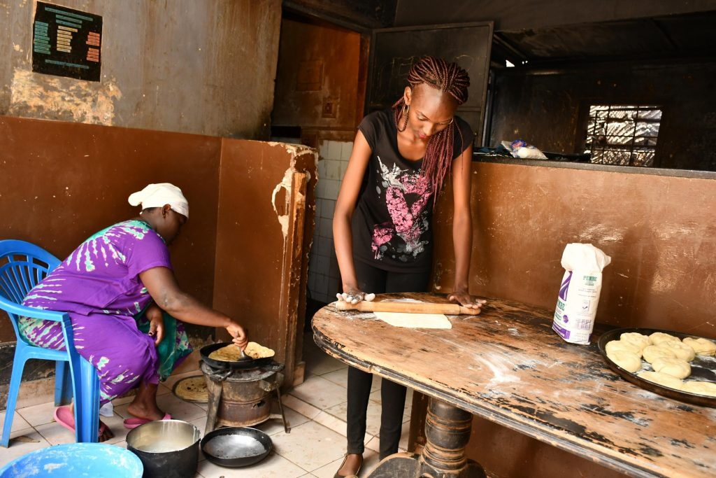 Faith Amondi assists in preparing a meal for the children at Mama Fauzia Children's Home